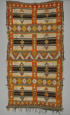 Object Name: Rug Local Name: l'ahmal n'ibouli Place Made: Africa: North Africa, Morocco, High Atlas Mountains People: Berber, Ait Ouaouzguite tribe Period: Early to mid 20th century Date: 1920 - 1940 Dimensions: L 273 cm x W 146 cm Materials: Wool Techniques: Knotted pile; twined; weft-faced; fringed