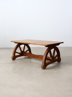"circa 1940s This is a vintage Monterey style coffee table. The wood California ranch table features a faux wood finish, ""plank"" top, and wagon wheel shaped legs. - Monterey style coffee table - wood t"
