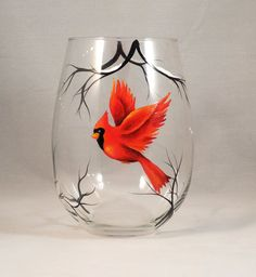 Elegant hand painted Cardinal in a winter setting.    Make my glasses a beautiful and personal gift for somebody special in your life. Each glass is