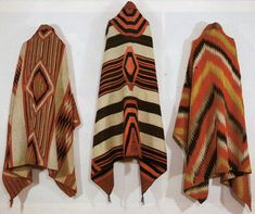 Left to Right: Navajo Classic Serape with all natural dyes, c. 1860, Navajo Third Phase Chiefs Blanket with Ravelled Bayeta, Cochineal, Lac and Indigo dyes, c. 1870, Navajo Transitional textile, c. 1880.
