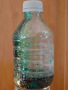 Use a bottle, some corn syrup and found objects to create a magical glitter treasure bottle or calm down jar. Calming Bottle, Calming Jar, Glitter Sensory Bottles, Glitter Jars, Glitter Glue, Calm Down Jar, Calm Down Bottle, Toddler Preschool, Toddler Crafts