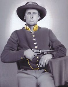 Marion Long (1843-1920). Enlisted in the Civil War for the Union from Missouri in 1863 at age 20. Pvt. in Companies, I and F in the 8th Regt., Missouri Calvary. In May, 1864, he was transferred to Co. K, 11th MO Calvary. One of his grandsons asked him if he ever got shot in the war. Marion told  him that he was loading his Navy Colt (chained to his belt) and was holding the reins of his horse in his mouth and a sharpshooter shot the reins out of his mouth, but did not hit him or his horse.