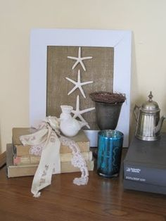 starfish. also saw a version of this with a long glassless frame, backed with burlap, with 3-4 4x6 pics pinned inside. love it!  could even mount each picture on scrapbook paper to match the seasonal decor of your house...