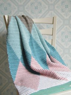 This blanket has been crocheted using the tapestry crochet technique. This makes it slightly thicker. Perfect for those slightly cooler