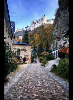 Salzburg, Austria   ~  Petersfriedhof with catacombs inside the mountain where the small turret is seen.