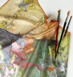 Hand painted silk scarf ( Etsy:: http://www.etsy.com/listing/59215770/silk-scarf-hand-painted-color-harmony )