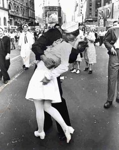 NYC. Times Square, August 14, 1945.. Celebrating the Surrender in V-J day. // Pictured is, arguably, the single most famous still image of the 20th century: a sailor kissing a nurse  (Alfred Eisenstaedt—Time & Life Pictures/Getty Images)