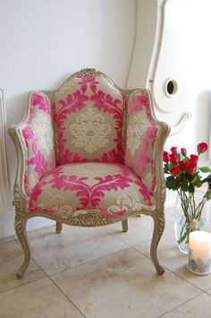 hot pink and tan damask chair. nice change from the usual black and white.
