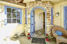 Welcoming entry way with stone work and blue accents