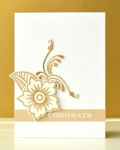 The flowers and swirls from Hennah Elements were stamped and embossed in gold on water color paper.