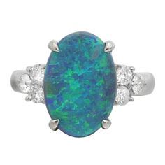 Opal Diamond Platinum Cluster Ring | From a unique collection of vintage cluster rings at https://www.1stdibs.com/jewelry/rings/cluster-rings/