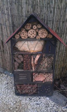 We helped build one at a recent festival. Very fun, and it can have a moss & succulent roof which makes it pretty. Bug Hotel, Garden Bugs, Garden Art, Wild Bees, Mason Bees, Outdoor Classroom, Hotels, Garden Projects, Diy Projects