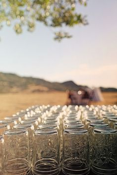 COOL IDEA FOR A COUNTRY WEDDING!!! Mason jars for drinks!  so want to do this