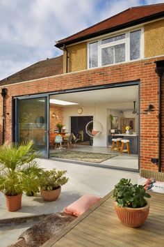 a chic extended home with an open plan Shaker style kitchen Real Homes Extension Veranda, House Extension Plans, House Extension Design, Extension Designs, Roof Extension, Flat House Design, Open Plan Kitchen Dining Living, Open Plan Kitchen Diner, Kitchen With Living Room