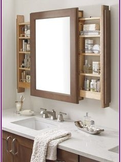 Minimalist bathroom 86483255332244235 - The Vanity Mirror Cabinet with Side pullouts is a bathroom storage innovation, assisting morning multi-taskers by keeping the mirror front-and-center. Source by lilemine Bathroom Vanity Designs, Bathroom Mirror Cabinet, Mirror Cabinets, Bathroom Design Small, Bathroom Interior Design, Modern Bathroom, Bathroom Vanities, Minimalist Bathroom, Bathroom Vanity Storage