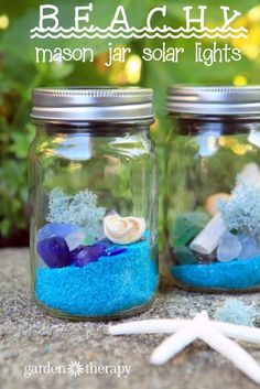 Beach Glass Solar Lights - These beachy solar lights are like little treasure jars filled with the calming blue, purple, and green tones of beach glass. The light reflects off of found seashells and a puff of reindeer moss, but the glass almost looks electrified they way it glows!
