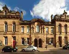 Queen's Hall Arts (QHA) is the charitable company that manages the venue, Queen's Hall Arts Centre, Hexham and provides an art service to a large part of rural Northumberland. The Queen's Hall is a magnificent early Victorian building which faces Hexham Abbey (dating from 647AD).  From its christening as an arts centre in 1983 until the hand over to the charitable organisation, Queens Hall Arts in 2001, the building was under local authority control. The building is shared with Hexham…
