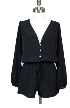 Black long sleeve romper with buttons. Made of 100% polyester. Made in the USA. Shoptulas.com