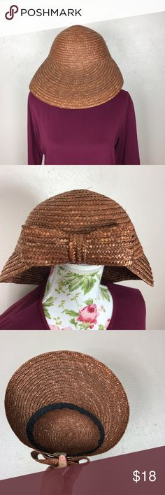 Front brim straw hat with Bow Gorgeous dark colored Straw hat with broom in front and bow detail and back. In excellent condition. Vintage Vintage Accessories Hats