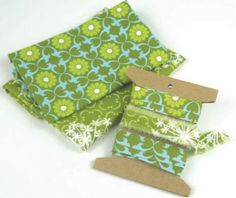 Make your own fabric tape with left over fabric and double-sided tape.