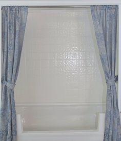 Beautiful blue shower curtain and large Tubcut - www.tubcutswfl.com