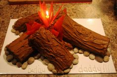 Campfire Cake I made for my husbands birthday! (Jelly Roll Cakes + Rice Krispie Treat bars to hold up the center logs.