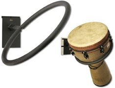 Description Warranty Information Displays a djembe at an angle and faces either direction. Well protected with padded tubing. Guitar Hanger, Guitar Wall, Tool Organization, Organizing Tools, Guitar Storage, Slat Wall, Wall Installation, Music Store, Display