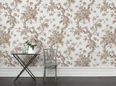 A photo wallpaper with a classic rose pattern against a cream, linen-coloured background.