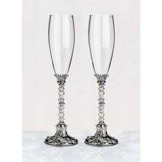 This pair of Silver Beaded Wedding Flutes contain a series of silver and clear beads decorate the middle portion of the stems. These silver wedding toasting flutes are a unique set that will make a wonderful keepsake long after the wedding.