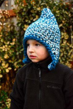 Ear flap hat crochet pattern from Aesthetic Nest for boys, girls, men, women and babies.