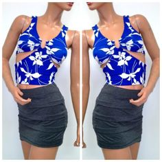 """Trendy Floral Print Cut Out Summer Crop New XS Made by: BOA John 3:16 Beautiful Blue and White Floral Material w/Texture, Sleeveless Top. Tag States M However this fits like a XS . Please see measurements below. This has a V Neck Style with a silver Metal Horse Shoe Shape with Clear Crystal Gems at the Top. -at the V This creates a gathered design at the chest area. Cut outs at the side. Material: 97%Polyester/3%Spandex Measurements:  Underarm to Underarm 12""""+Stretch Shoulder to crop Length…"""