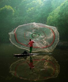 Amazing shot by Asit, a photographer from Jakarta, Indonesia.  One of an extremely interesting series.
