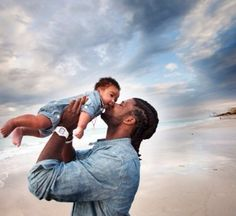Devin Hester with his son. Tough on the field...teddy bear off the field. So sweet...