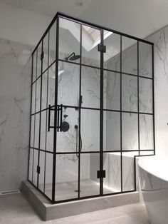 Beautiful black framed shower enclosures with French doors by Ultimate Glass Art, Inc. We specialize in black framed glass shower doors and glass shower enclosures and black shower hardware in Chicago. Contact Ultimate Glass for custom glass shower designs, www.ultimateglassart.com
