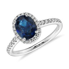 The magnificent and holy Sapphire, in all its celestial hues, is a stone of wisdom and royalty, of prophecy and Divine favor. It is forever associated with sacred things and considered the gem of gems, a jewel steeped in the history and lore of nearly every religion. Sapphire and Micropavé Diamond Halo Ring in 14k White Gold (8x6 mm)