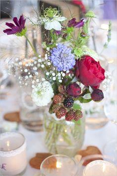 wildflower and raspberry centerpiece #weddingreception #wildflowers #weddingchicks http://www.weddingchicks.com/2014/03/19/lavender-and-silver-switzerland-wedding/