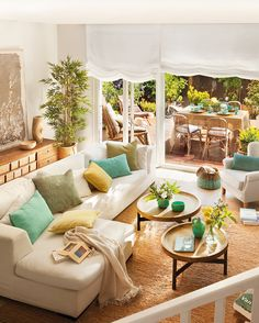 beautiful living space with access to patio area and teal accents Schöner Wohnraum mit Zugang zur Te Home And Living, Tropical Living Room, Living Room Designs, Home Living Room, Coastal Living Rooms, Living Decor, Beautiful Living Rooms, Yellow Living Room, Home Deco