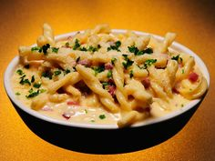 Smoked Gouda And Serrano Ham Mac N Cheese recipe from IVillage. Ingredients: pound unsalted butter, cup diced serrano ham, cup all-purpose flour, kosher salt to taste, 1 quart heavy whi. Pork Recipes, Pasta Recipes, Great Recipes, Favorite Recipes, Cheese Recipes, Ham Mac And Cheese, Macaroni N Cheese Recipe, I Love Food, Good Food