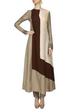 Manish Malhotra This set features a beige, brown and cream panelled kurta in dupion crepe base with embroidered cuffs paired with oyster dupion crepe pants. Stylish Dress Designs, Stylish Dresses, Fashion Dresses, Kurti Patterns, Dress Patterns, Pakistani Outfits, Indian Outfits, Indian Designer Outfits, Designer Dresses