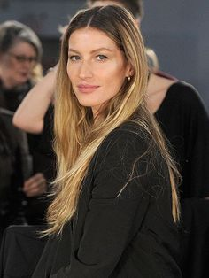 Gisele Bundchen with straight hair backstage at Alexander Wang's fall 2012 show | allure.com