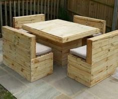 Pallets Outdoor Furniture: Here is another decent sitting arrangement. Here you can see four two seated pallets made sofas or benches, along with a robust center table. This is a whole lot of fun space for your friends and family. Who ever is going to be seated in here would definitely adore your effort for making this pallet furniture master piece.
