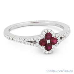 The featured ring is cast in 18k white gold and showcases a centerpiece flower design adorned with round cut red rubies and round cut diamond accents all the way around the flower design and along the splitshank bands.
