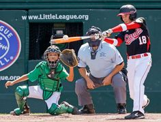 Ottawa, Canada's Angus Adams (18) hits a two-run home run in front of Taoyuan, Taiwan catcher Chen-Hsun Lee during the fourth inning of a game in International pool play at the Little League World Series in South Williamsport, Pa. on Friday. (Gene J. Puskar/AP)