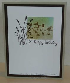 "By Sharon Graham. Uses Stampin' Up ""Wetlands"" set. Mask with a square cut into scrap & placed over cardstock panel. Sponge. Stamp birds. Remove mask. Stamp grass and sentiment. Add brown panel to frame & adhere to card front."