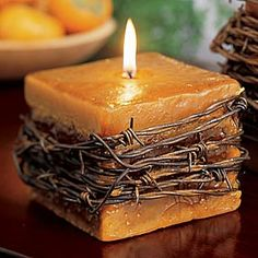 Barb wire around square candle