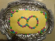 """Homemade birthday cake decorated with pastel colored peanut """"M+Ms"""" candies (available in Spring)."""