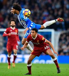 Brighton's English midfielder Izzy Brown (L) jumps against Liverpool's English midfielder Trent Alexander-Arnold (R) during the English Premier League football match between Brighton and Hove Albion and Liverpool at the American Express Community Stadium in Brighton.Brighton lost 1 v 5 and have gone five home leagues games without a win (D4 L1) for the first time since April 2015.
