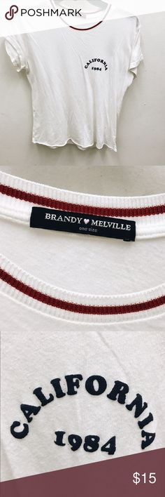 "Brandy Melville ""California 1984"" Tee Brandy Melville white ""California"" tee with red collar trim detailing. Excellent condition, no Trades! Brandy Melville Tops Tees - Short Sleeve"