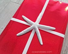 Great coastal inspired wrapping idea- seashells and holiday paper!