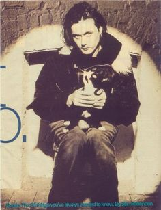 Brett Anderson of Suede, and a tuxedo cat. Celebrities With Cats, Celebs, Brett Anderson, Britpop, Cat People, Rock Legends, Image Collection, Cool Cats, Alter